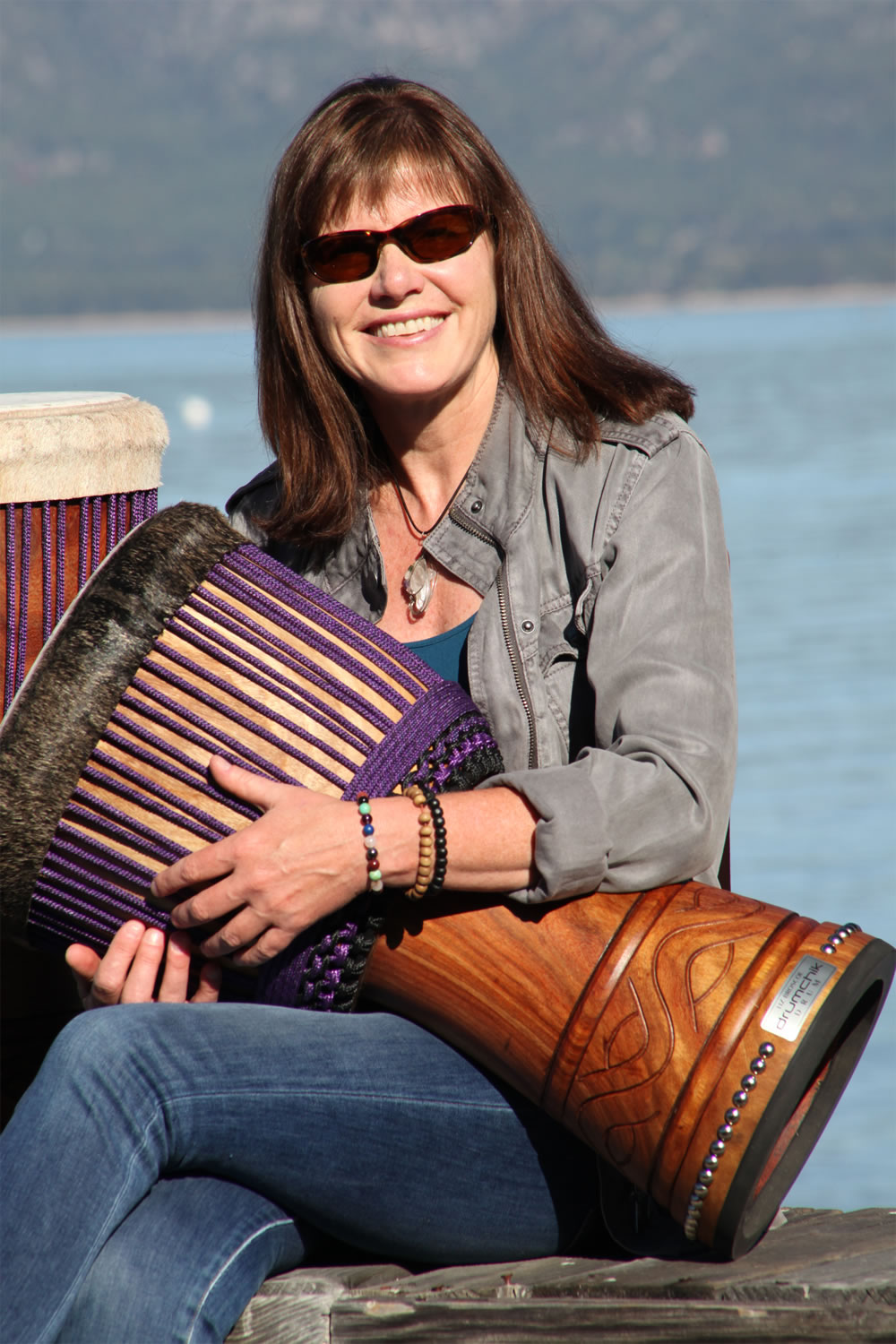 Liz broscoe and drumchik drum in lake tahoe